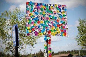 """sticker tree"" outside the Oil Sands Discovery Center in Fort McMurray, Canada"