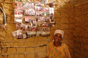 Jeanne Noah, Bagyeli anti-oil activist below a photo-collage of the places she has traveled as a Bagyeli spokesperson